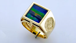 Custom ammolite ring set in gold